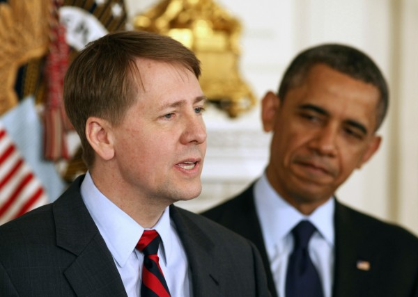 U.S. President Barack Obama (R) stands next to Richard Cordray after Obama announced Cordray's renomination to lead the Consumer Financial Protection Bureau in the State Dining Room of the White House in Washington, Jan. 24, 2013.