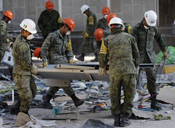 Mexican soldiers remove debris at the headquarters of state-owned oil giant Pemex in Mexico City Feb. 4, 2013. Mexican rescue workers found three more bodies over the weekend amid the rubble of a deadly blast that tore through state oil firm Pemex's main office complex, the government said, as search efforts appeared to near a close. The death toll from Thursday's explosion stands at 36, Pemex said via Twitter. Rescue workers had been digging through the last sections of the building's basement and could soon call off their search. One person was reported still missing.
