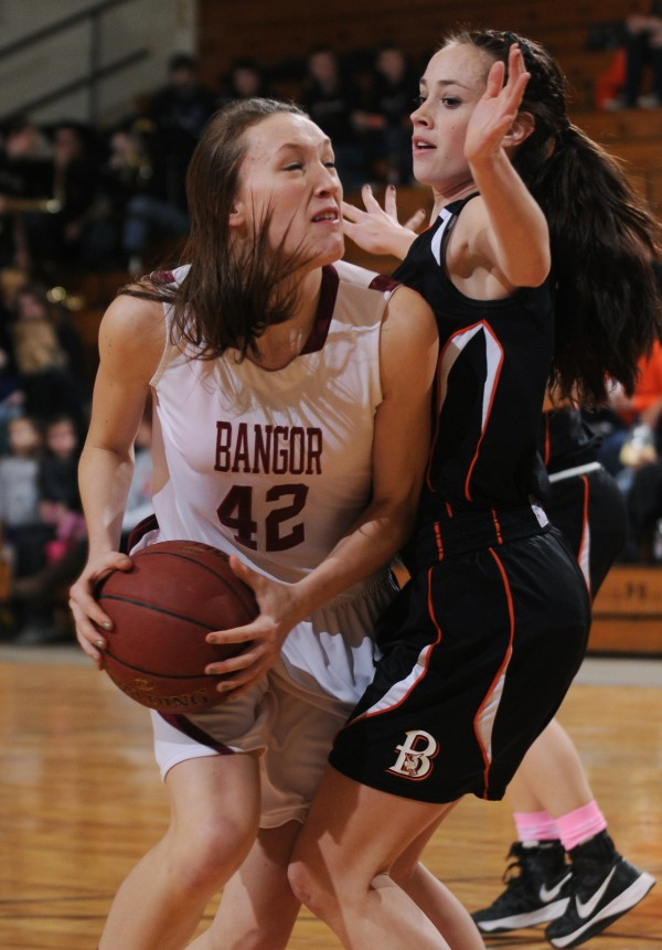 Bangor's Mary Butler runs into Brewer's Lindsay Houp as she attempts to shoot during first period action on Thursday, Feb. 7, 2013, at the Bangor Auditorium.