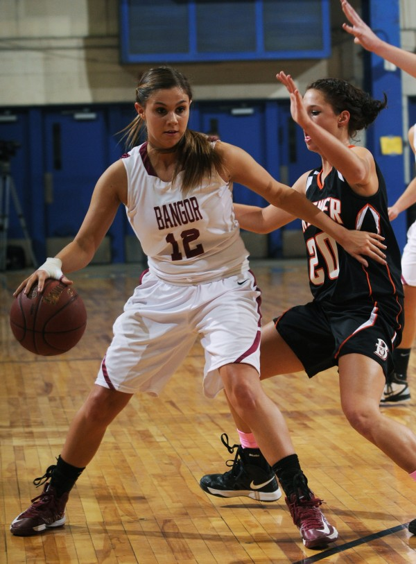 Bangor's Jordan Seekins dribbles against Brewer's Maddy Bailey on her way to the hoop against Brewer on Thursday, Feb. 7, 2013, at the Bangor Auditorium.