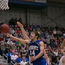 Lawrence's Spencer Carey drives to the basket against Hampden at the Augusta Civic Center on Friday, Feb. 22, 2013.