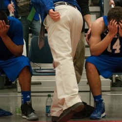 Lawrence's Xavier Lewis (left) and Spencer Carey (right) cover their faces after losing on a last second, game-winning buzzer beater against Hampden for the Class A state championship at the Augusta Civic Center on Friday, Feb. 22, 2013.