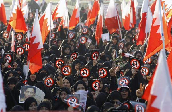 Protesters hold banners with sign &quotNo U Turn&quot meaning &quotNo Returning Back&quot and hold Bahraini flags as they participates in a rally organised by Bahrain's main opposition society Al Wefaq, in Budaiya west of Manama, Bahrain, February 6, 2013.
