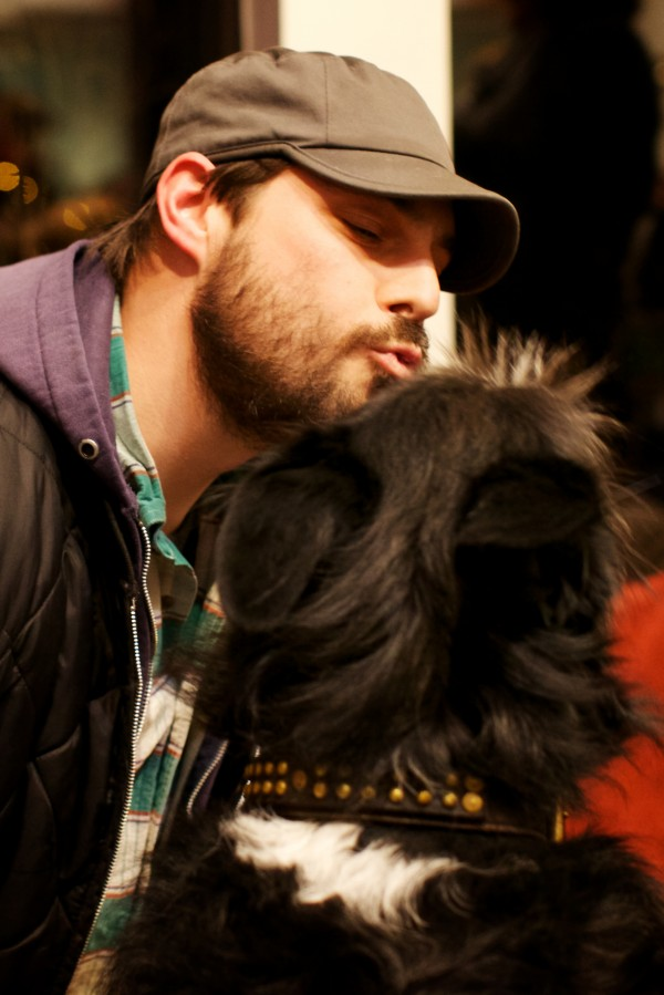 Travis Smith puckers up for his dog Ziggy at the 9th annual Valentine's Day Canine Kissing Contest and Cocktail Party at the Planet Dog Company Store in Portland Tuesday night Feb. 12, 2013.