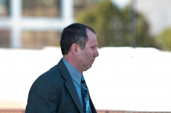Peter Robinson leaves the Penobscot Judicial Center after a judge heard pretrial motions on Thursday, March 21, 2013.
