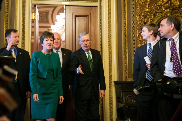 Sens. Susan Collins. R-Maine, John Cornyn, R-Texas, and Mitch McConnell, R-Ky., prepare to greet President Barack Obama on Capitol Hill in Washington, D.C., on Thursday, March 14. The Senate narrowly passed a budget for the first time in four years early Saturday morning, March 23.