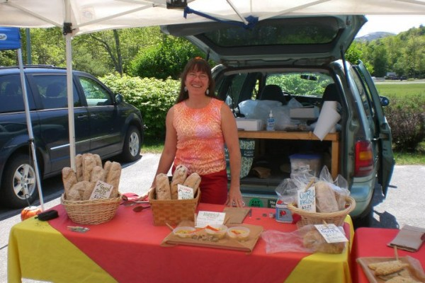 Billie Barker, in slightly warmer weather, selling her baked goods and savory treats at a farmer's market.