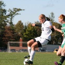Lainey Herring of the University of Maine-Presque Isle (left) tries to maneuver the ball around Kiersten Zufelt of UMaine-Machias during a 2012 soccer game.