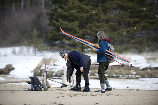 Maime LaFrance of Brooklin (left) and Anita Babson of Sullivan pick up their cross-country skis from the sand of Sand Beach before skiing out of Acadia National Park. Visitors to Acadia this April will have have access to Sand Beach and Ocean Drive but will have to wait a month later then normal to be able to drive up Cadillac Mountain or cruise the Park Loop Road due to cuts in funding brought on by the sequestration.