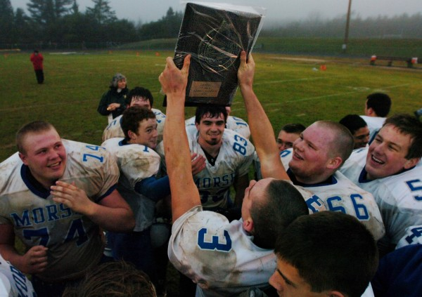 Members of the Morse High School football team celebrate  their win over Mt. Desert Island on the field at MDI High School on Saturday, Nov. 15, 2008. Morse won 10-7.