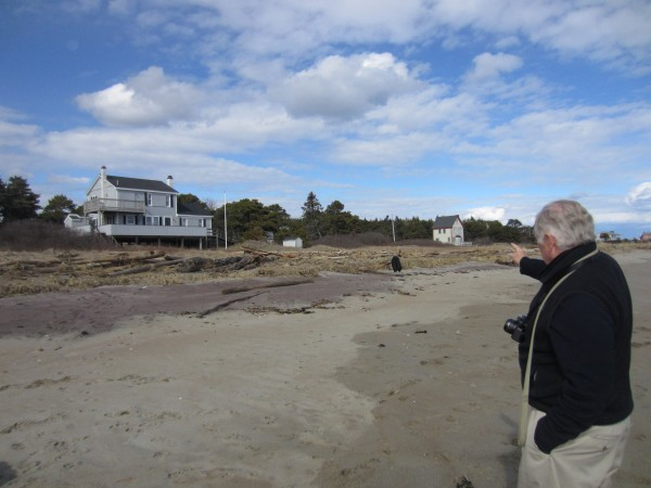 Fred Hill points to the area northeast of his family's cottage where homes fell into the sea during the winter of 1976. Hill's family raised their home  — at the time a single-story ranch — onto telephone poles to keep the house from getting swept out to sea.
