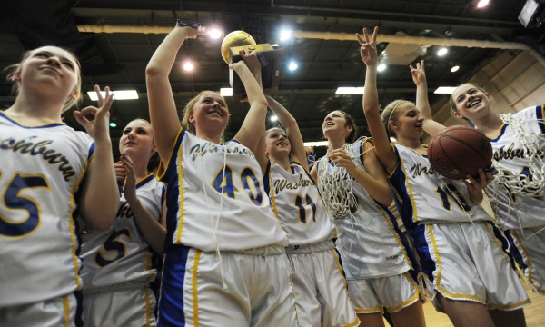 Washburn's girls basketball team celebrates with the gold ball after defeating Richmond 75-55 in the Class D state championship on Saturday, March 2, at the Bangor Auditorium.
