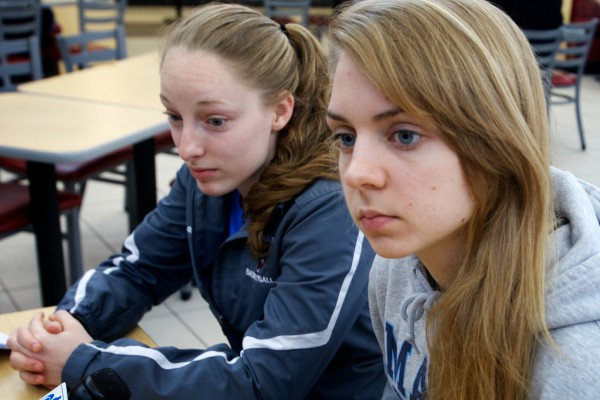 During a stop at the Kennebunk rest stop on the Maine Turnpike Wednesday, University of Maine women's basketball players point guard Courtney Anderson (left) and forward Liz Wood talk about the crash that wrecked their team bus Tuesday night.