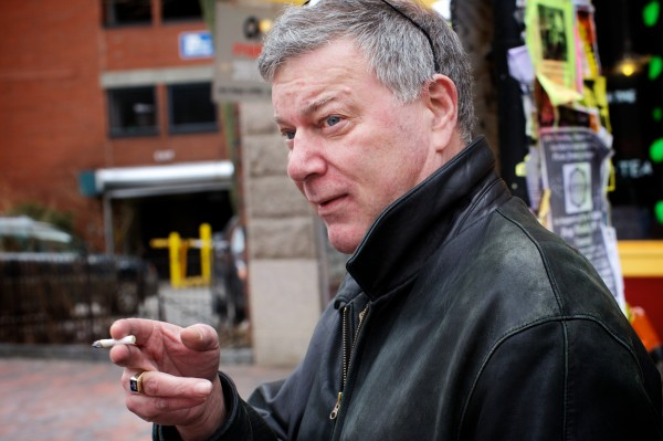 Steve Kelley puffs away in Portland's Monument Square despite the city's ban on smoking in public places Wednesday. Kelley said he's careful not to smoke in the square if it's full of people, like on crowded farmers market days.
