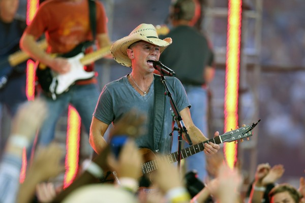Kenny Chesney performs at halftime of the game with the Dallas Cowboys playing against the Washington Redskins during a game on Thanksgiving at Cowboys Stadium on Nov. 22, 2012.