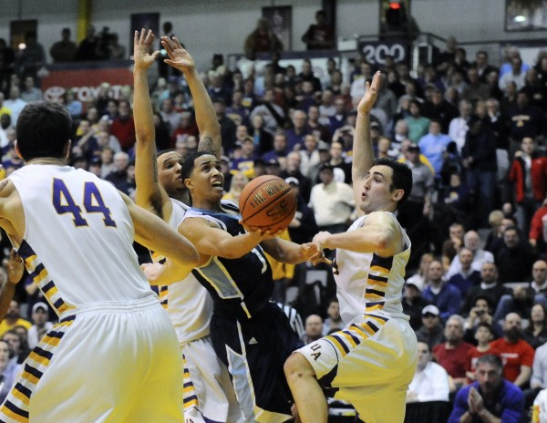 Maine's Justin Edwards attempts a shot at the end of the game with Maine down by one in an America East quarterfinal against host Albany Saturday night  Albany defeated Maine 50-49 and advances to semifinal action Sunday.