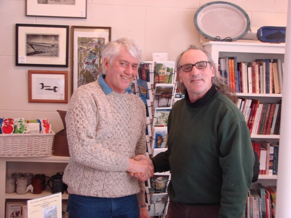 JD Rule shaking hands with Michael Scivani, one of Lubec's Selectmen.
