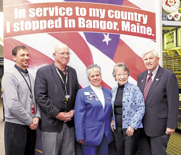 Bangor International Airport Director Tony Caruso, president of the Bangor Troop Greeters Chuck Nolan, Maine Ladies Auxiliary State President Cindy Cowling, Veterans of Foreign War Ladies Auxiliary President Leanne Lemley, and Bangor City Council Chairman Nelson Durgin celebrated the proud heritage of the U.S. military during Lemley's visit to Bangor.