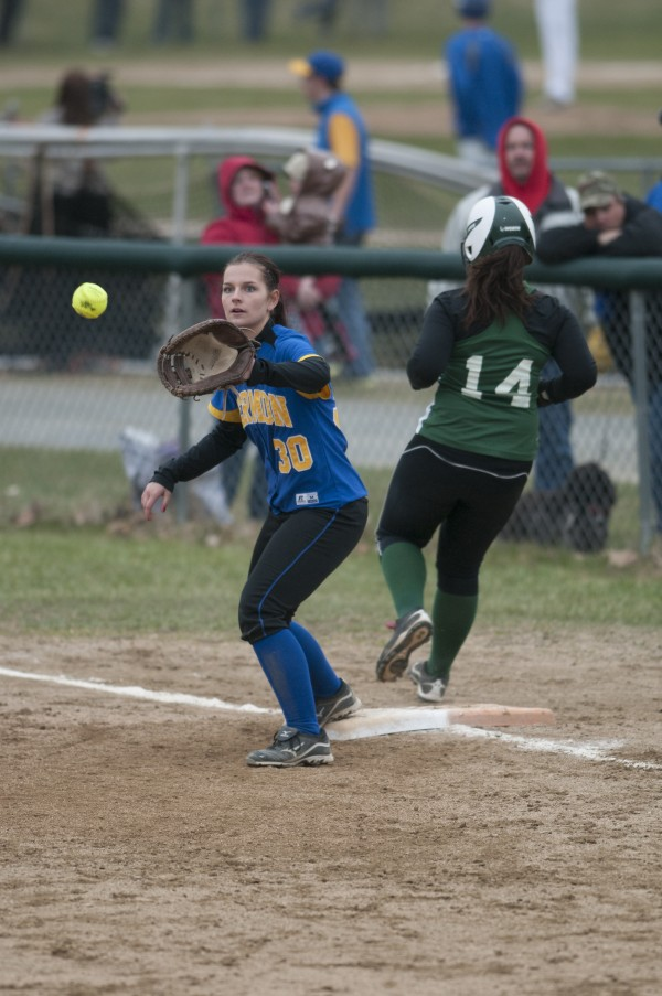 Old Town's Meghan Leighton beats the throw to first base against Hermon's Shannon Graves on Tuesday, April 23, 2013.