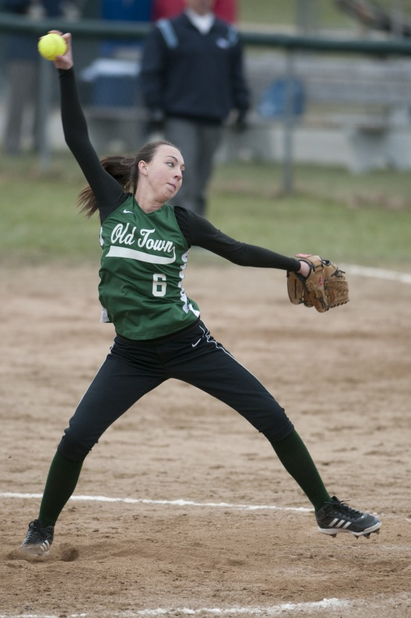 Old Town pitcher Kendra Hayward winds up a pitch against Hermon on Tuesday, April 23, 2013.