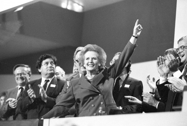 Then-British Prime Minister Margaret Thatcher points skyward as she receives standing ovation at Conservative Party Conference in this October 13, 1989 file photo. Thatcher has died following a stroke, a spokesman for the family said.