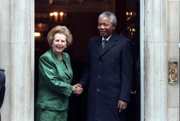 African National Congress leader Nelson Mandela (right) is greeted by British Prime Minister Margaret Thatcher prior to their talks, at 10 Downing Street in this July 4, 1990 file photo. Former British Prime Minister Thatcher has died following a stroke, a spokesman for the family said.