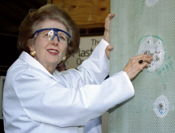 Baroness Thatcher examines a sheet of bullet-proof material during a visit to a factory producing ballistic and blast protection products in this April 9, 1997 file photo. Margaret Thatcher, the &quotIron Lady&quot who dominated British politics for two decades, died on April 8, 2013 following a stroke, a spokesman for her family said. She was 87.