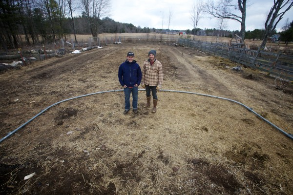 Tyler Gaudet (left) and Jackson Mcleod of Fluid Farms stand on the spot where they plan to build a 100-foot greenhouse where they'll grow table herbs and tilapia fish.