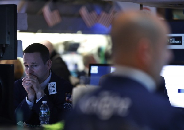 Traders work on the floor of the New York Stock Exchange on Wed., April 3, 2013, a day in which the S&P 500 posted its biggest daily decline in more than a month.