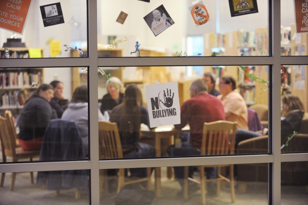 A no bulling sign is seen in the window of the library of Mt. View high school as members of the National Alliance of Mental Illness meet with the public behind locked doors to talk about suicide prevention and grieving.