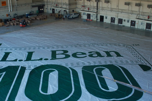 L.L.Bean is recycling the Fenway Park tarp -- last year's 100th anniversary infield cover. They are making tote bags out of it. One of our Brunswick Landing tenants, New England Tent and Awning, is cutting it up for them. Hangar 5 is the only building large enough to handle the project.