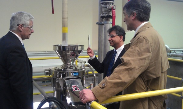 Hemant Pendse (center), director of the University of Maine's Forest Bioproducts Research Institute, and Michael Bilodeau (right), director of UMaine's Process Development Center, lead U.S. Rep. Mike Michaud on a tour of the university's new Cellulose Nanofiber Pilot Plant during the Paper Days conference on April 3, 2013.