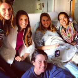 Sarah Girouard, second from right, is surrounded by friends at Tufts Medical Center in Boston on Monday, April 15, after being treated for injuries from the Boston Marathon bombing. The bomb partially damaged her hearing and sent shrapnel into the right leg of the Northeastern University junior and 2010 graduate of Falmouth High School.