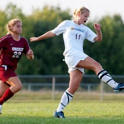 In this September 2009 photo, then-Falmouth High School senior Sarah Girouard, right, makes a play in a soccer game against Greely High School. Girouard, now 20, was injured by one of the Boston Marathon bombs on Monday, April 15.