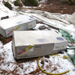 Boxes of Sysco Bacon remain at the site that Christopher Knight, known locally as the North Pond Hermit, called home.