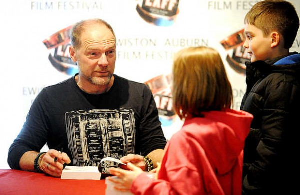 &quotSurvivorman&quot Les Stroud talks with Julia Savard, 6, and Cole Savard, 9, of Lewiston at the kickoff to the Lewiston Auburn Film Festival in Lewiston on Thursday. Stroud also will present a concert with his band at 9:30 p.m. Saturday at the Ramada Inn and Conference Center in Lewiston.