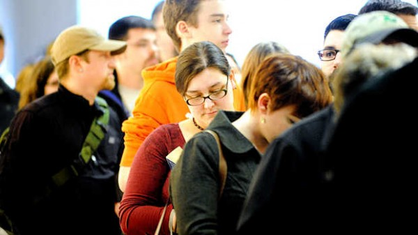 Jennifer Blocher of Woonsocket, R.I., reads &quotTime of Omens&quot as she waits in line to meet Les Stroud of the TV show &quotSurvivorman&quot on Thursday in Lewiston.