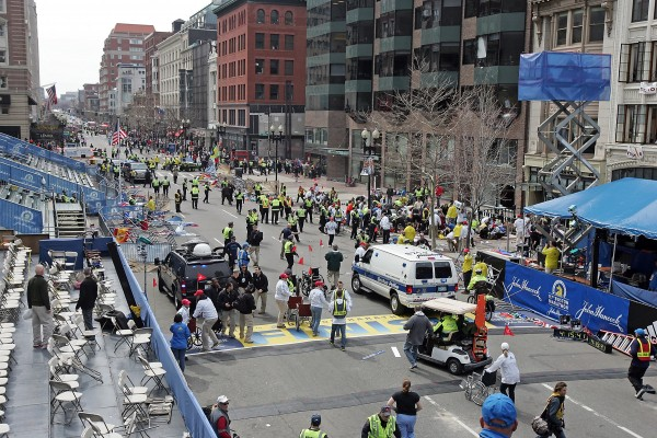 Emergency personnel assist the victims at the scene of a bomb blast during the Boston Marathon in Boston, Massachusetts, Monday, April 15, 2013.