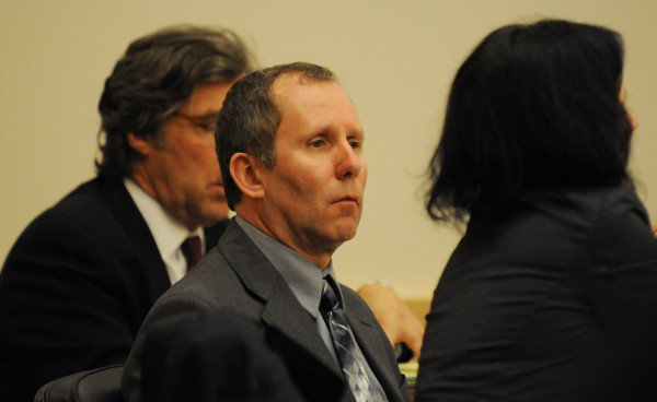 Peter Robinson sits between his attorneys Thomas Hallet, left, and Molly Butler-Baily as Assistant Attorney General Andrew Benson gives his closing remarks to the jury Robinson's murder trail on Monday at the Penobscot Judicial Center in Bangor. Robinson is charged with murder in the Nov. 12, 2011 slaying of David Trask of Hudson.