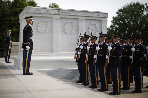 Members of the U.S. Army's Old Guard stand alongside the Tomb of the Unknowns during a wreath-laying ceremony at Arlington National Cemetery near Washington, on May 10, 2013.