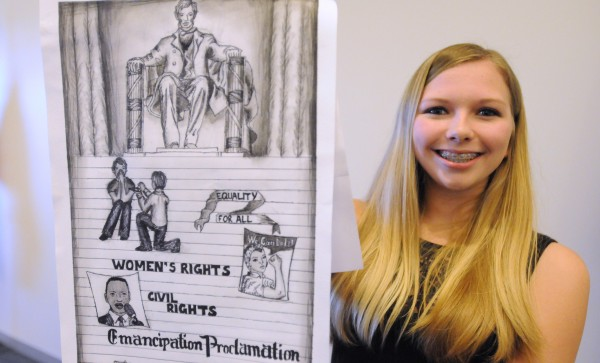 Katherine Higgins, 14, of Dixmont with the poster she entered in the Law Day essay and art contest. Higgins' work was the winner in the art category.