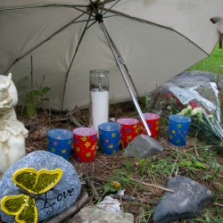 Community members left messages and candles at a memorial dedicated to Nichole Cable near her home in Glenburn on Tuesday. Cable's body was found in Old Town on Monday. Community members have planned fundraisers and memorial events to benefit Cable's family.