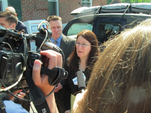 York County Assistant District Attorney Justina McGettigan fields questions from reporters outside the York County courthouse in Alfred Friday morning after the sentencing of Alexis Wright, who pleaded guilty to 20 misdemeanor counts for her role in a high-profile Kennebunk prostitution case.