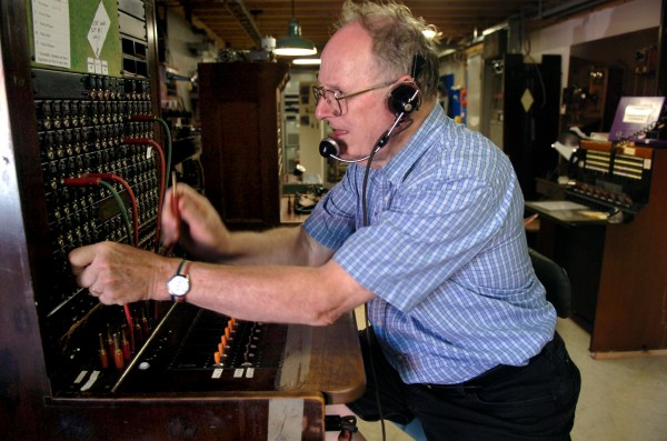 David Thompson of Bucksport demonstrates what it was like to work a manual switchboard at The Telephone Museum in Ellsworth in 2007.