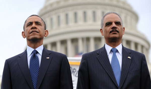 President Barack Obama and Attorney General Eric Holder attend the 32st Annual National Peace Officers' Memorial Service at the West Front Lawn of the U.S. Capitol on Wednesday in Washington, D.C.