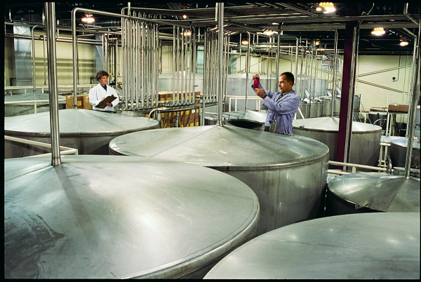 Workers at White Rock Distilleries in Lewiston, now operated by Beam Inc., inspect some of their product. The company said sales of Maker's Mark, one of Beam's high-end bourbons, soared 44 percent after people rushed to buy bottles because of worries the company would lower its alcohol content.