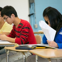 Chinese students Michelle Xiang (right to left), David Li and Michael Gao look over their practice AP statistics exam at Orono High School on Thursday, May 9, 2013.