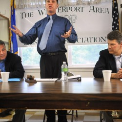 Bernie Littlefield, center, talks about the rules of debate between then-Reps. Mike Thibodeau, R-Winterport, and John Piotti, D-Unity, at Grant Civic Center in Winterport in May 2010. The lawmakers were discussing a tax reform package that was repealed by voters the next month.