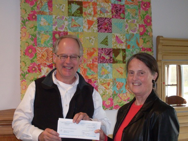 Habitat Executive Director Jimmy Goodson gratefully receives the MaineCF grant check from Mary Blackstone, member of the Hancock County Fund committee of the Maine Community Foundation