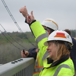 Demolition crew, who watched the cables cut from the safety of the Penobscot Narrows Bridge, give workers the thumbs up after the last suspension cable was cut on the defunct Waldo-Hancock Bridge on Thursday, May 16, 2013.